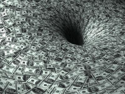 Geldvernichtung (Foto: Mike Kiev - Fotolia.com)