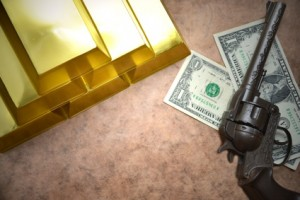 Shining golden bullions lie near old gun and two dollar banknotes