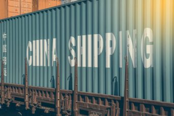 China cargo container at train trailer, shipping concept. Made with shallow dof and vintage style.