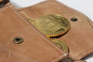 Goldmünze im Geldbeutel
