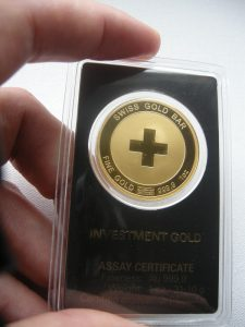swiss-gold-bar-hand